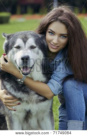 Beautiful Woman With Malamute Dog