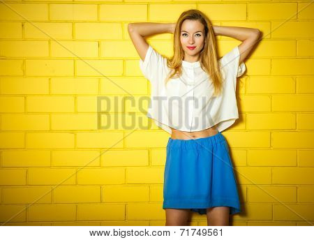 Portrait of Trendy Hipster Girl at the Brick Wall
