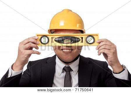 Asian Businessman Hold A Spirit Level In Front Of His Eyes And Smile