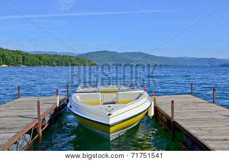 Yellow Boat At Dock On A Lake
