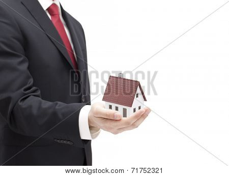 Businessman with house miniature in hand isolated on white
