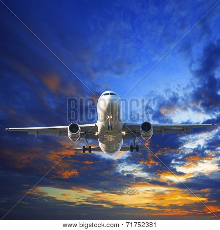 Passenger Jet Plane Preparing To Landing Against Beautiful Dusky Sky Use For Traveling Industry And