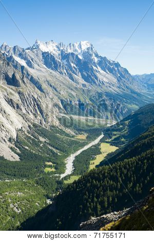 Val Veny valley in Val d'Aosta, in Italy, with Dora di Val Veny river and forests on hillsides.