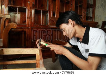 Portrait of man working on furniture
