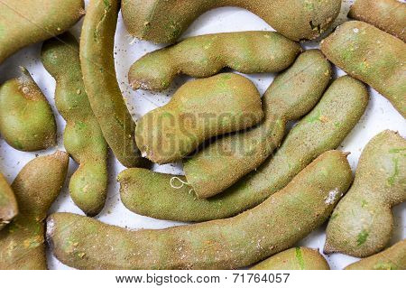 A close-up freshly plucked tamarind kept on an isolated background