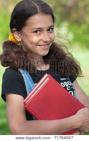 Teen Girl With Books On Nature