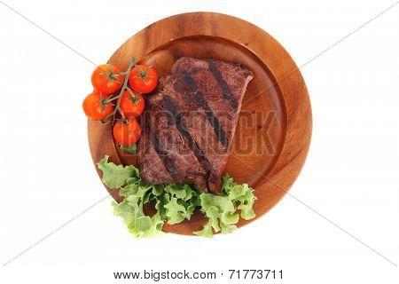 fresh beef steak grilled barbecue fillet on wooden dish with vegetable green salad and cherry tomatoes isolated over white background