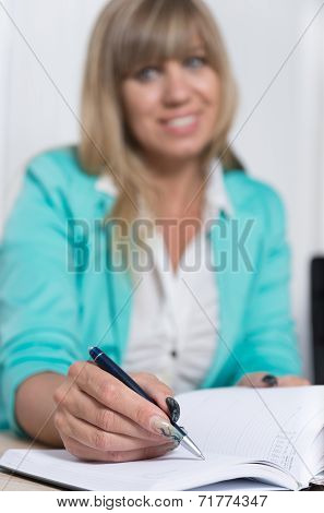 Woman Is Writing Into An Appointment Calendar