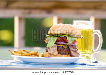 Burger, Fries And Beer On The Deck
