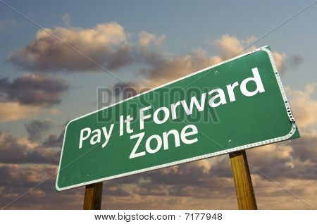 Pay It Forward Zone Green Road Sign And Clouds