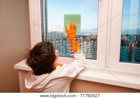 A Boy Washes A Window