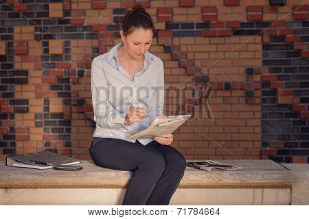 Young Businesswoman Sitting In A Foyer