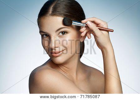 Beautiful girl with tassel