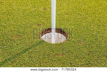 The Golf Hole And Flag On Green Grass Of Golf Course In Thailand