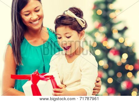 holidays, presents, christmas, x-mas concept - happy mother and child girl with gift box