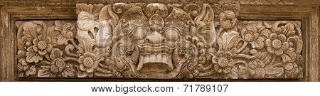 Horrible Mythical Monster Face. Stone Relief From Indonesia, Bali Island