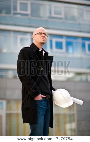 Architect With Helmet And Plan