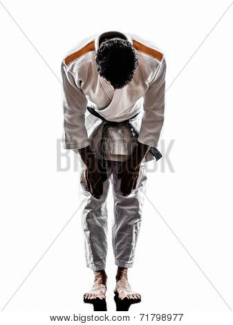 one judoka fighter man in silhouette saluting on white background