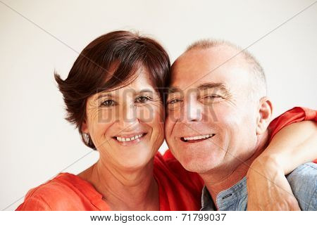 Portrait Of Happy Middle Aged Hispanic Couple