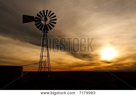 Silhouette Of Farm Windmill At Sunset