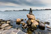 Постер, плакат: The Little Mermaid Is A Bronze Statue By Edvard Eriksen Depicting A Mermaid The Sculpture Is Displ