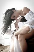 picture of caress  - Young beautiful couple having romantic fun on the beach - JPG