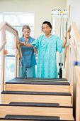 foto of upstairs  - Portrait of male patient being assisted by nurse in moving upstairs - JPG