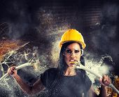 picture of rebel  - Attractive rebel girl breaks big electrical cables - JPG