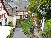 stock photo of moselle  - traditional houses on narrow street in Beilstein village Moselle region Germany - JPG