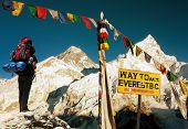 foto of buddhist  - evening view of Everest with tourist and buddhist prayer flags from Kala Patthar signpost and blue sky  - JPG