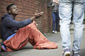 picture of begging  - Homeless Teenage Boy Begging For Money On The Street - JPG