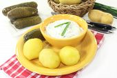 image of curd  - Herb curd with boiled potatoes and pickled cucumber  - JPG