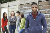 stock photo of gang  - Gang Of Teenagers Hanging Out In Urban Environment