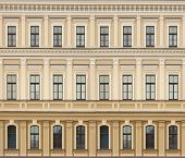 stock photo of neoclassical  - Neoclassic architecture wall with windows vintage building background - JPG