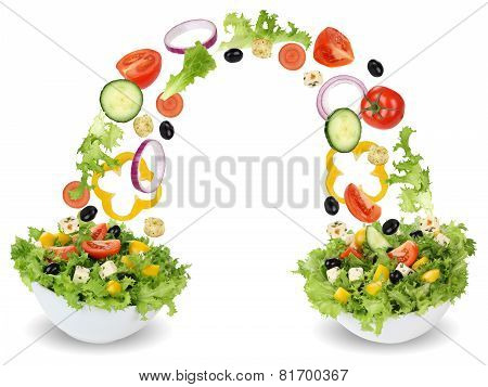 Flying Salad Ingredients In Bowl With Tomatoes, Onion, Olives And Cucumber