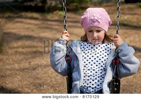 Little Girl In The Swing