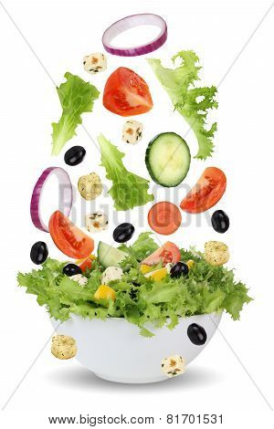 Falling Salad In Bowl With Lettuce, Tomatoes, Onion And Olives