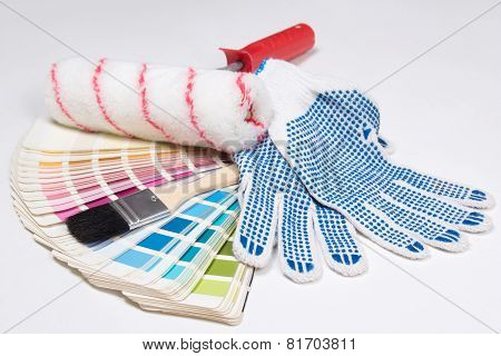 Painter's Tools - Brushes, Work Gloves And Colorful Palette Over White