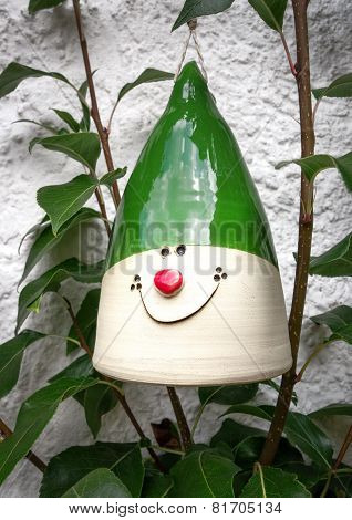 Ceramic decoration with a smiling face