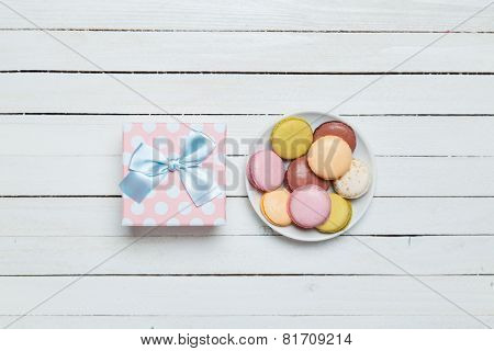 Macaron And Gift On White Table.
