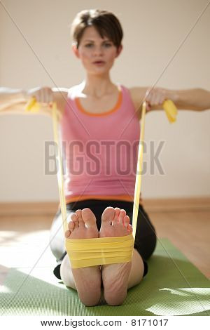 Young Woman Exercising with Resistance Bands