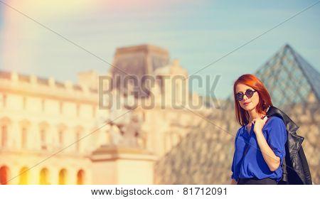 Redhead Women Near Pyramid In Louver, Paris