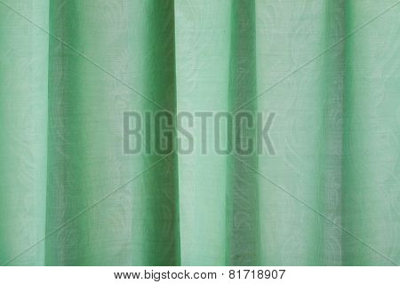 Close-up View Of Bright Green Curtain