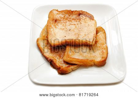 Three Slices Of French Toast On A White Plate