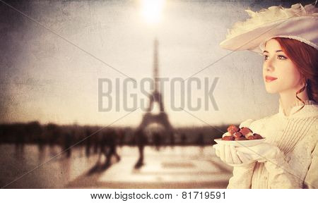 Beautiful Redhead Women With Candy In Paris
