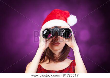 Brunette Girl With Binocular And Hat On Violet Background.