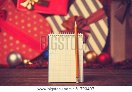 Notebook And Pencil With Christmas Gifts