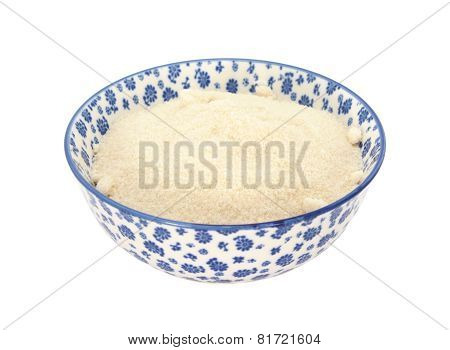 Golden Caster Sugar In A Blue And White China Bowl