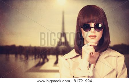Style Girl In Sunglasses And Tour Eiffel On Background.