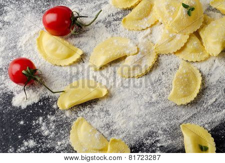 Italian Raw  Ravioli On A  Black Table.